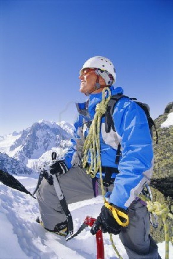 3196261-mountain-climber-coming-up-snowy-mountain-smiling